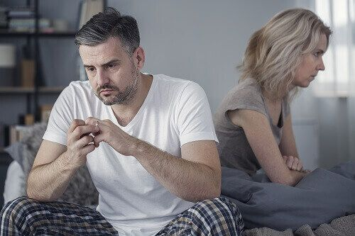 Upset couple looking away from each other considering divorce